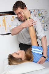 Chris muscle-testing a client using the anterior serratus muscle.
